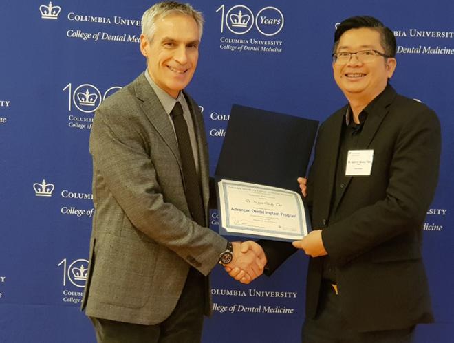 Bác sĩ Nguyễn Quang Tiến nhận bằng Implant tại ĐH Columbia (New York).