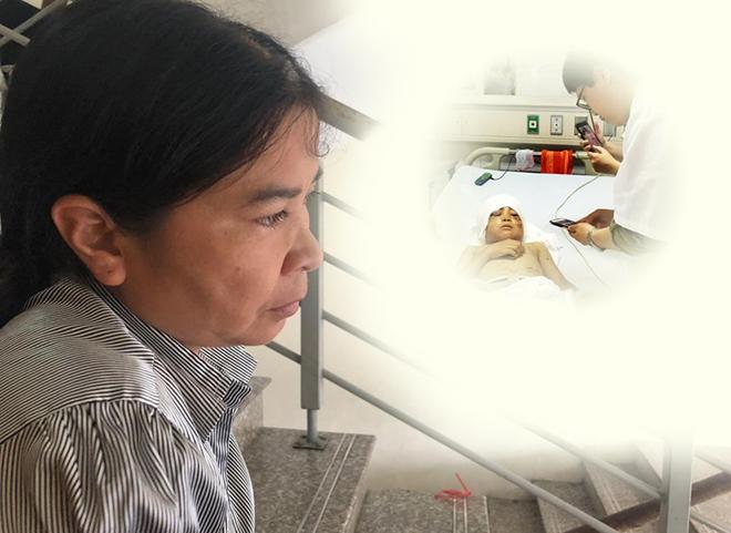 Chị Minh đang chăm sóc con trai điều trị ở Bệnh viện Hữu nghị Việt Đức, sáng 5/5. Ảnh: ThùyAn.