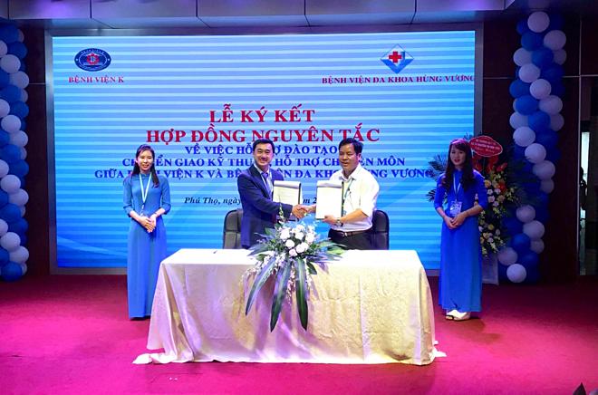 Lễ ký kết giữabệnh viện K trung ương và bệnh viện Đa khoa Hùng Vương. Ảnh: Bắc Nguyễn