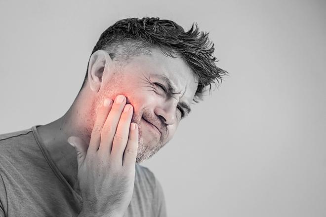 Răng khôn gây đau đớn, bất tiện đối với nhiều người. Ảnh: The James Clinic