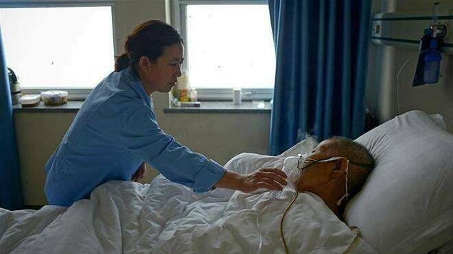 Trung Quốc ghi nhận 59 người mắc viêm phổi cấp, trong đó 1 người tử vong do nhiễm virus mới corona. Ảnh: AFP.