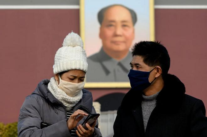 Người dân Trung Quốc đeo khẩu trang phòng bệnh viêm phổi. Ảnh: AFP