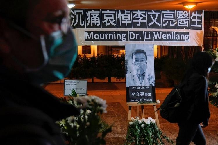 Đám tang của bác sĩ Lý Văn Lượng vào ngày 6/2. Ảnh: Reuters