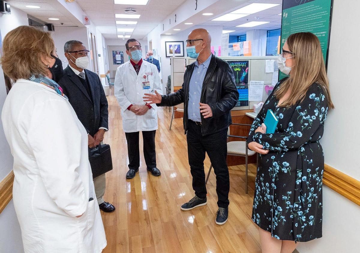 Moncef Slaoui, in a leather jacket, toured Temple University Hospital on November 20.  Photo: USA Today.