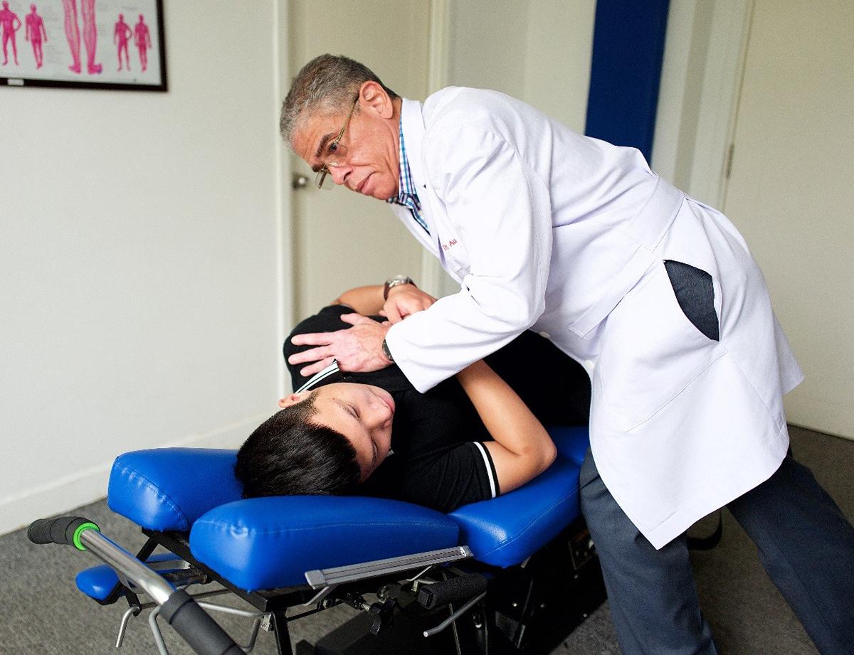 Dr. Aubrey Gail performed spinal manipulation procedures for the patient.  Photo: Tea Mi.