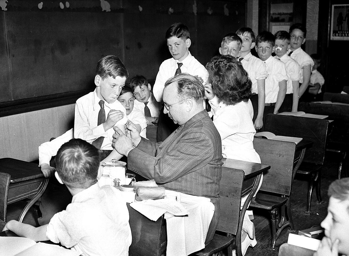 St.  Joan of Arc Parochial of Jackson Heights, Queens, was vaccinated with smallpox, April 1947.  Photo: NY Daily News