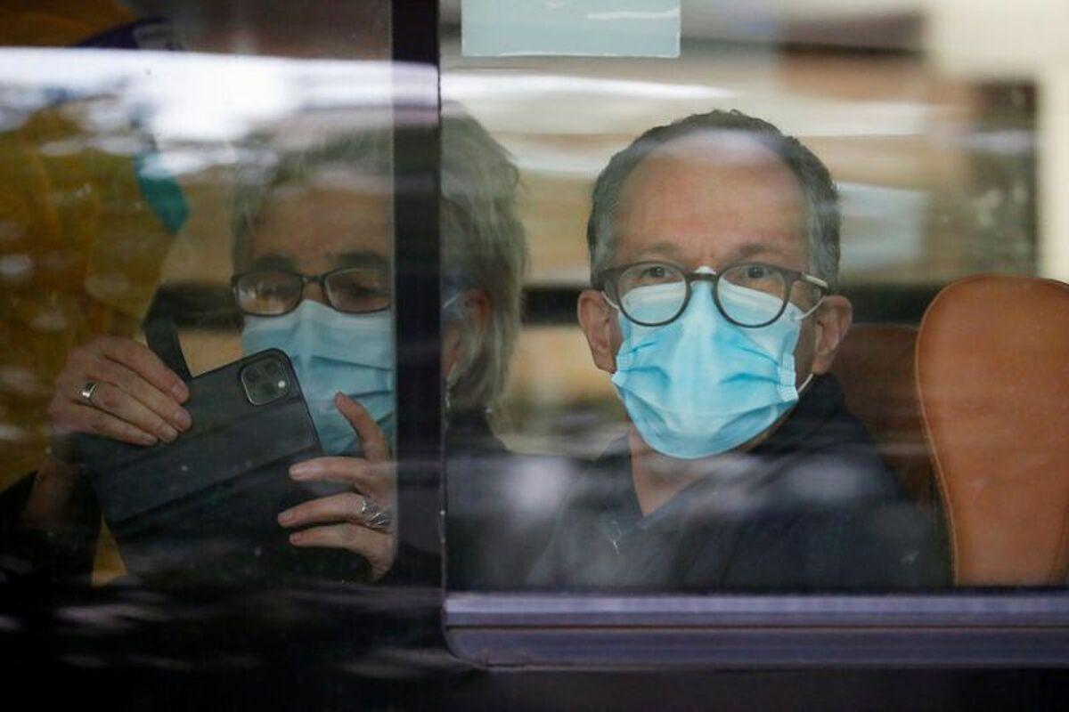 Chuyên gia phái đoàn WHO có mặt tại Vũ Hán để điều tra nguồn gốc nCoV, ngày 14/1. Ảnh: AFP